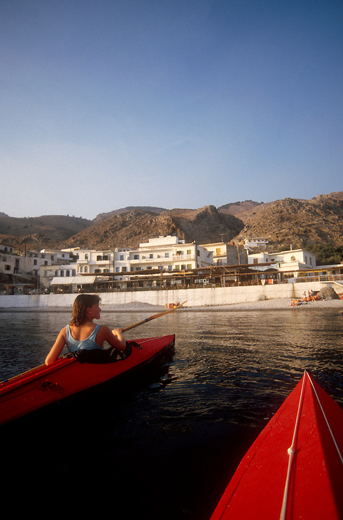 Crete, Greece, Sea kayakers, Crete's southwest coast, approaching breakfast in Khora Sfakion, Mediterranean Sea, Europe, Sarah Shannon, released,.