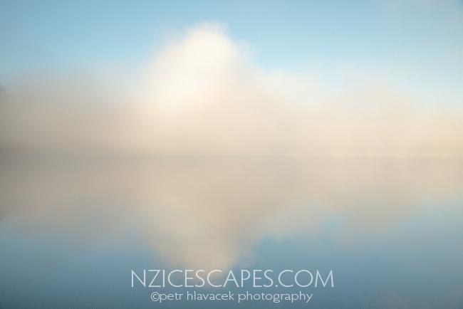 Sunrise over Lake Mapourika with winter fog, Westland Tai Poutini National Park, West Coast, UNESCO World Heritage Area, New Zealand, NZ