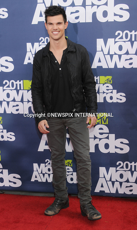 "TAYLOR LAUTNER.attends the 2011 MTV Movie Awards at the Gibson Amphitheatre on June 5, 2011 in Universal City, California.Mandatory Photo Credit: ©Crosby/Newspix International. .**ALL FEES PAYABLE TO: ""NEWSPIX INTERNATIONAL""**..PHOTO CREDIT MANDATORY!!: NEWSPIX INTERNATIONAL(Failure to credit will incur a surcharge of 100% of reproduction fees)..IMMEDIATE CONFIRMATION OF USAGE REQUIRED:.Newspix International, 31 Chinnery Hill, Bishop's Stortford, ENGLAND CM23 3PS.Tel:+441279 324672  ; Fax: +441279656877.Mobile:  0777568 1153.e-mail: info@newspixinternational.co.uk"