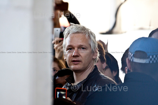 """Julian Assange - 2011<br /> <br /> London, 15/10/2011. St Paul's Square became the stage of the UK arm of the """"Occupy"""" protest movement which has been growing around the world. The Occupy movement is a world-wide protest against the financial crises created by the actual financial system, by speculation, by deregulation, and by the actions of major international financial and investment banks. Around 2,000 protesters armed with tents and placards, gathered outside the famous Cathedral intending to occupy Paternoster Square, home of the London Stock Exchange and the heart of the City of London, but they were hampered by City police officers. After this failed attempt the protesters decided to camp in front St Paul's where the situation with police forces became immediately tense. Masked like the character of Guy Fawkes from the movie """"V for Vendetta"""", Julian Assange appeared on the square to give a speech in support of the protesters. During the late evening police forces heavily armed with riot control equipment charged the square, attempting to evict the occupants who resisted. Later in the evening the police retreated and the occupation continued peacefully."""