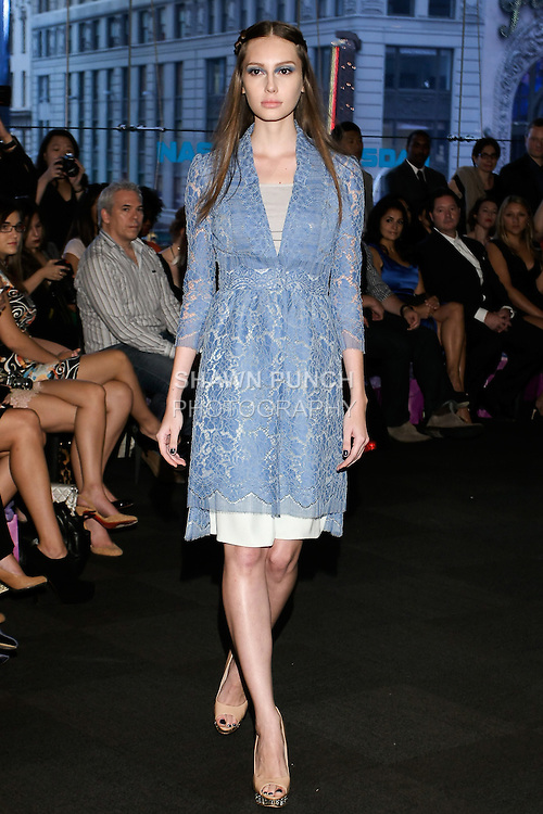 """Model walks runway in a light blue lace jacket dress with mint shorts and light blue lace, from the Yuna Yang Spring Summer 2013 """"Close your eyes and see the world"""" collection, at the NASDAQ Marketsite, during New York Fashion Week, on September 7, 2012."""