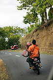 INDONESIA, Flores, a family rides on a motorbike in the Ngada District