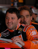 Mar 30, 2007; Martinsville, VA, USA; A crew member makes faces as Nascar Nextel Cup Series driver Tony Stewart (20) climbs into his car during practice for the Goody's Cool Orange 500 at Martinsville Speedway. Martinsville marks the second race for the new car of tomorrow. Mandatory Credit: Mark J. Rebilas
