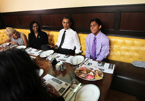 United States President Barack Obama (2nd R) chats with campaign volunteers during a lunch August 10, 2011 at Ted's Bulletin in Washington, DC. Obama had lunch with campaign volunteers who were selected based on essays they wrote about organizing.  .Credit: Alex Wong / Pool via CNP