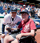 Joey Jacobsen, Nevada's 2012 Children's Miracle Network Hospitals Champion Child, threw out the first pitch before the  Reno Aces vs Sacramento River-Cats game played on Sunday afternoon, April 22, 2012 in Reno, Nevada.  Joey met Aces manager Brett Butler before the game.