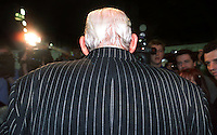 Instantly recognisible, even from behind, Rev Ian Paisley, aka the Big Man, faces media questioning after arriving at the election count centre in the King's Hall, Belfast, N Ireland.  In this UK General Election on 7th June 2001 Paisley's Democratic Unionist Party won 5 seats, a gain of 3 seats from the Ulster Unionist Party.  200106079365<br />