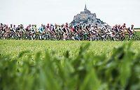 Picture by Alex Broadway/ASO/SWpix.com - 17/04/2016 - Cycling - Tour de France 2016 - Stage One - Mont-Saint-Michel to Utah Beach Sainte-Marie-du-Mont - The peloton passes Mont-Saint-Michel.<br />