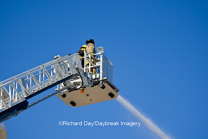 63818-02309 Firefighters extinguishing warehouse fire using aerial ladder truck, Salem, IL