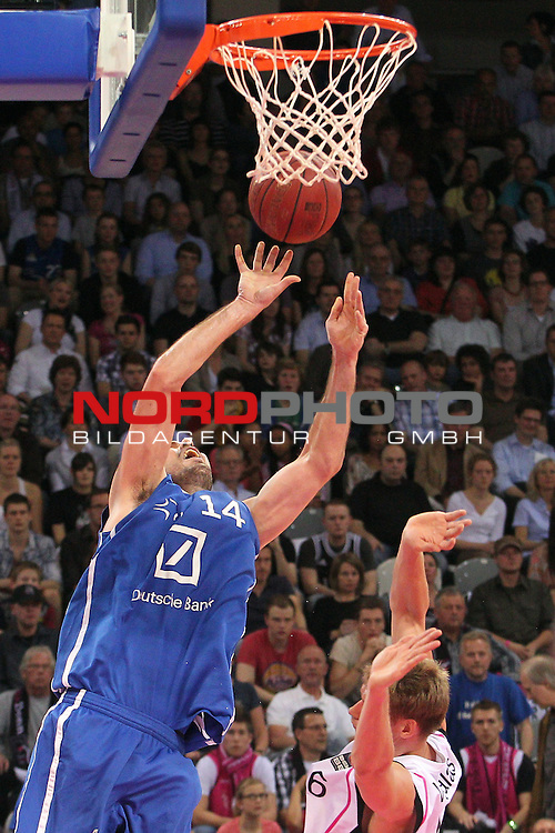 28.04.2012, Telekom Dome, Bonn, GER, Beko BBL, Telekom Baskets Bonn vs FraPort Skyliners, im Bild<br /> Marius Nolte (Frankfurt #14) trifft gegen Benas Veikalas (Bonn #6)<br /> <br /> // during the Beko BBL, Telekom Baskets Bonn vs FraPort Skyliners on 2012/04/28, Telekom Dome, Bonn, Germany. Foto &copy; nph / Mueller *** Local Caption ***