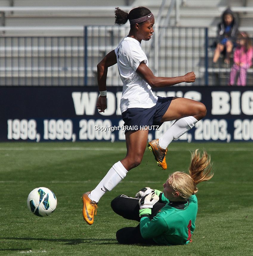 Penn State's Maya Hayes (5) shot is blocked by Minnesota goalkeeper Cat Parkhill (1) on Sept. 30, 2012. Photo/©2012 Craig Houtz