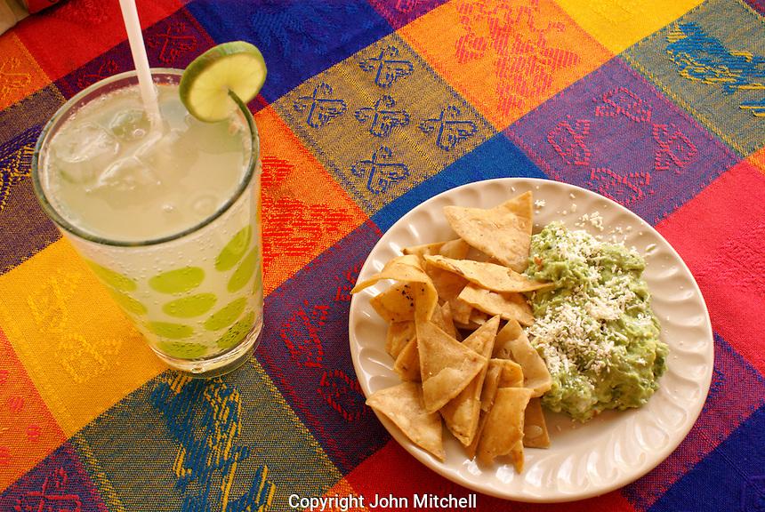 Guacamole, chips, and glass of lemonade or limonada, Cholula, Puebla, Mexico.