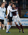 Stenny's Queen of the South's Mark Durnan and Stenny's Ross McMillan clash off the ball.
