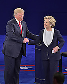 Former United States Secretary of State Hillary Clinton, the Democratic Party nominee for President of the US and businessman Donald J. Trump, the Republican Party candidate for President of the US, shake hands at the end of the second of three presidential general election debates at Washington University in St. Louis, Missouri on Sunday, October 8, 2016.<br /> Credit: Ron Sachs / CNP