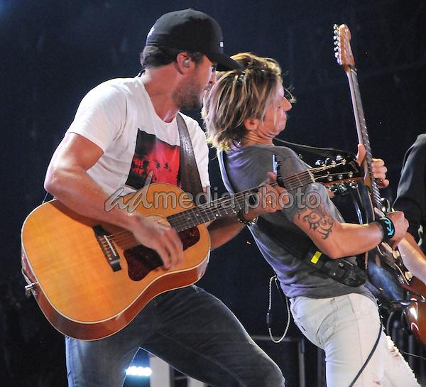 12 June 2016 - Nashville, Tennessee - Luke Bryan and Keith Urban. 2016 CMA Music Festival Nightly Concert held at Nissan Stadium. Photo Credit: Dara-Michelle Farr/AdMedia