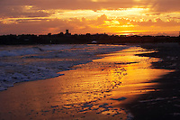 USA, Middletown, RI 2007 - A dramatic sunset spreads over second or Sachuest beach creating a glistening reflection on the sand, near Newport, RI.