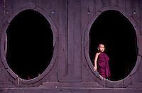 Images from the Book Journey Through Colour and Time. A novice Monk at the 18th Century Shwe Yan Paya Pagoda and the oval shape Monastery, near Inle Shan State, Myanmar