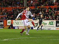 Mark Reynolds passes back under pressure from Sam Parkin in the Aberdeen v St Mirren Scottish Communities League Cup match played at Pittodrie Stadium, Aberdeen on 30.10.12.