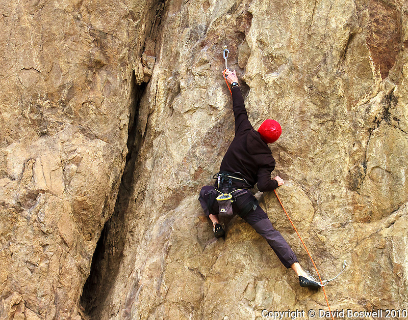 A polish climber enjoys the challenging rock faces in El Chalten, Argentina in Southern Patagonia.