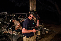 Daniel Schaan, 15, adjusts his night vision goggles as he prepares prior to his night boar hunt, at the Ox Ranch on 17th of August, 2017 in Uvalde, Texas, USA. <br /> Photo Daniel Berehulak for the New York Times