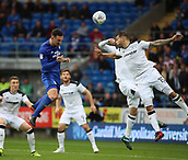 30th September 2017, Cardiff City Stadium, Cardiff, Wales; EFL Championship football, Cardiff City versus Derby County; Sean Morrison (C) of Cardiff City powers his head towards goal