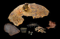 SAVEOCK WATER, CORNWALL, ENGLAND - AUGUST 03: A detail of archaeological finds on August 3, 2008 in Saveock Water, Cornwall, England. A fragment of an iron cauldron, a leather shoe sole, brass pins, finger nail pairings, human hair, heather stalks and a strip of silk and wool mix textile, were found in a votive pool by archaeologist Jacqui Wood who dates them between the medieval period to the 17th century (no carbon dating).  (Photo by Manuel Cohen)