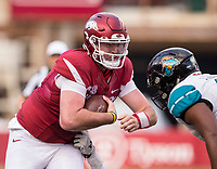 Hawgs Illustrated/BEN GOFF <br /> Cole Kelley, Arkansas quarterback, braces for a hit from Shane Johnson, Coastal Carolina linebacker, in the second quarter Saturday, Nov. 4, 2017, at Reynolds Razorback Stadium in Fayetteville.