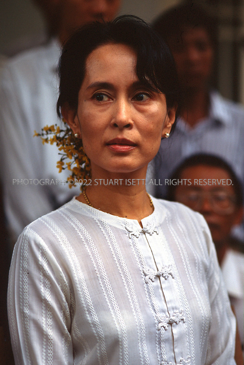 7/13/1995--RANGOON, BURMA..Aung San Suu Kyi in the garden of her home after her release on July 11 from house arrest.