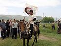 Armenia 2007 <br />  A Yezidi wedding in a village : the pillow of the bride showing to the guests<br /> Armenie 2007 <br /> Un mariage yezidi dans un village: l'oreiller de la mari&eacute;e et les invit&eacute;s