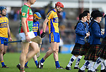 Paidi Fitzpatrick of Sixmilebridge leads out his team behind the band for the senior county final replay against Clooney-Quin at Cusack park. Photograph by John Kelly.