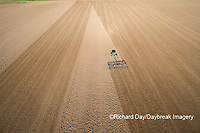 63801-10205 Farmer tilling field before planting corn-aerial Marion Co. IL