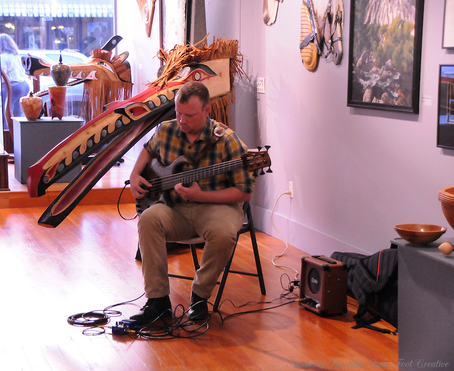 Musician Brian Plank entertains visitors to the Rectangle Gallery during Centralia, Washington's Third Thursday on September 15, 2016.
