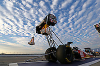 Feb 8, 2014; Pomona, CA, USA; The car of NHRA top fuel dragster driver Doug Kalitta is towed back to the pits following qualifying for the Winternationals at Auto Club Raceway at Pomona. Mandatory Credit: Mark J. Rebilas-