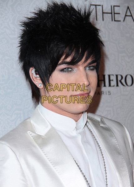 ADAM LAMBERT .Attending The Art of Elysium's 3rd Annual Black Tie Charity Gala Heaven.at the Beverly Hilton, Beverly Hills, CA, USA, January 16th 2010..arrivals  portrait headshot white make-up guyliner eyeliner earring ear pierce profile .CAP/ADM/TC.©T.Conrad/Admedia/Capital Pictures