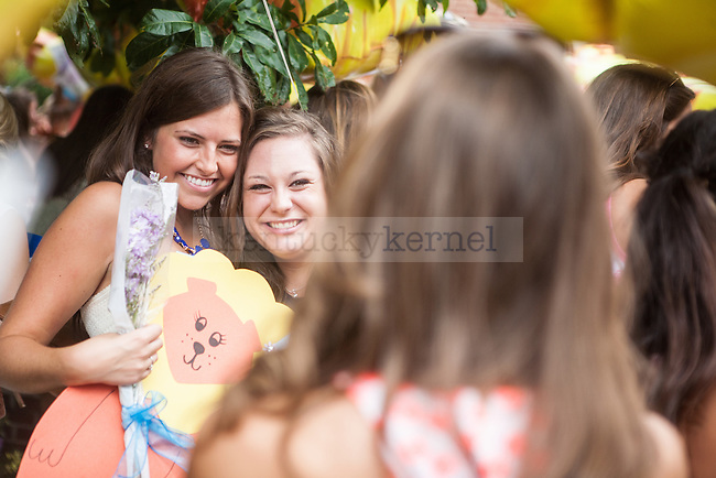 Two sisters of Alpha Delta Pi pose for a picture during UK's sorority bid day in Lexington, Ky., on Friday, August 22, 2014. Photo by Adam Pennavaria | Staff