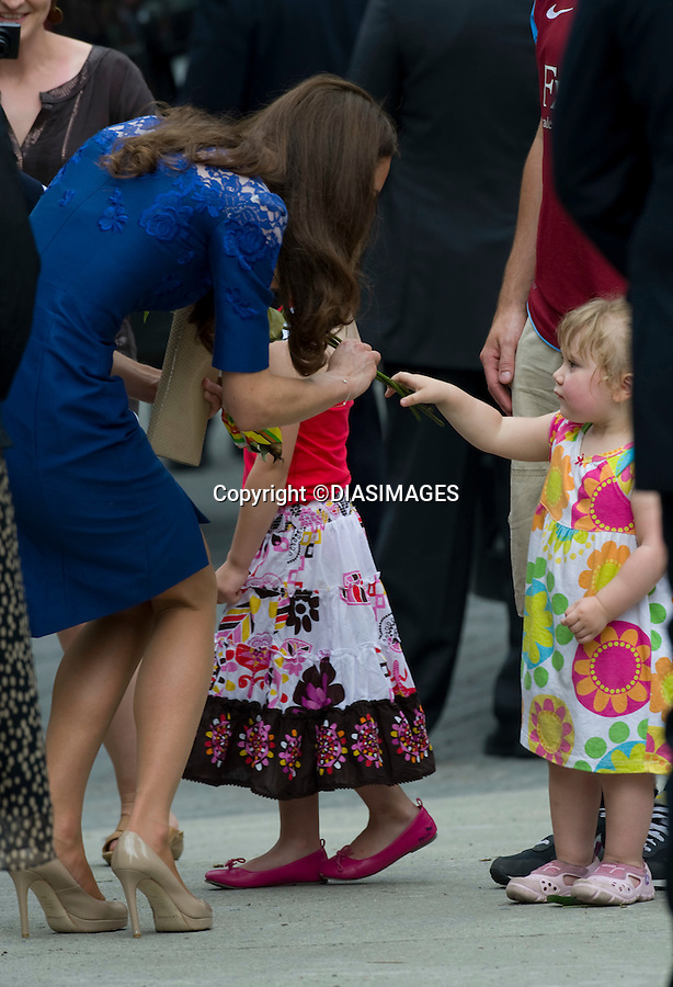 """WILLIAM & KATE IN QUEBEC_Kate Admits to wanting to have children.Kate showed her motherly instincts when stroking the head of shy 2-year-old Raffaela Cheater, the shy little girl who handed her flowers..Kate admiied to 28-year-old David Cheater later that the couple were hoping to start a family soon..The duke and Duchess of Cambridge were attending Freedom of The City Cerremony, City Hall , QuebecCity, Quebec_03/07/2011.Mandatory Credit Photo: ©DIAS-DIASIMAGES..**ALL FEES PAYABLE TO: """"NEWSPIX INTERNATIONAL""""**..IMMEDIATE CONFIRMATION OF USAGE REQUIRED:.DiasImages, 31a Chinnery Hill, Bishop's Stortford, ENGLAND CM23 3PS.Tel:+441279 324672  ; Fax: +441279656877.Mobile:  07775681153.e-mail: info@newspixinternational.co.uk"""