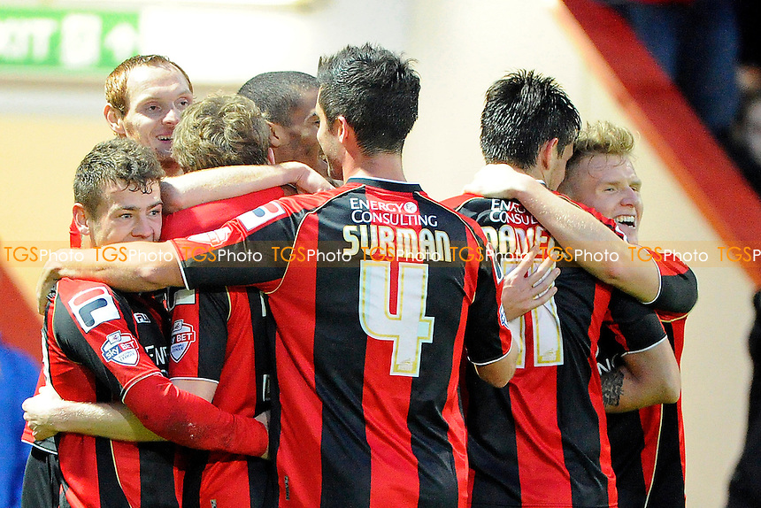 Group hugs after Eunan O'Kane of AFC Bournemouth after he  scores the third goal  - AFC Bournemouth vs Yeovil Town - Sky Bet Championship Football at the Goldsands Stadium, Bournemouth, Dorset - 26/12/13 - MANDATORY CREDIT: Denis Murphy/TGSPHOTO - Self billing applies where appropriate - 0845 094 6026 - contact@tgsphoto.co.uk - NO UNPAID USE