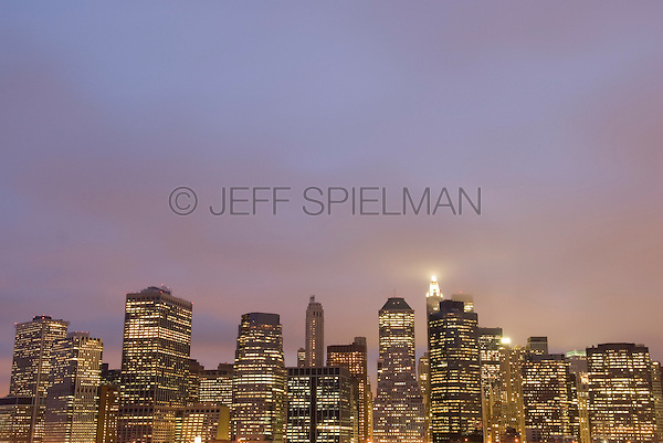 Lower Manhattan Financial District Skyline and Overcast, Cloudy Sky at Dusk, New York City, New York State, USA