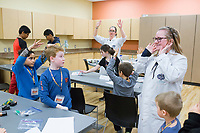 NWA Democrat-Gazette/CHARLIE KAIJO Instructor Erin Bahnmaier (right) gives instructions, Monday, November 25, 2019 during a two-day Mad Science camp at the Bentonville Community Center in Bentonville.<br /> <br /> Kids built circuits and learned how electricity flows in a two-day science camp led by a group of educators called Mad Science. They focused on how robots have a purpose and how they can determine that purpose. Their focus is to get kids excited about science through hands on activities. They partnered with the Bentonville Community Center to hold camps since the summer of 2018.