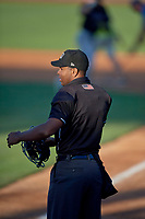 Umpire Chris Ford handles the calls behind the plate during the game between the Ogden Raptors and the Missoula Osprey at Lindquist Field on June 14, 2019 in Ogden, Utah.  The Raptors defeated the Osprey 4-3. (Stephen Smith/Four Seam Images)