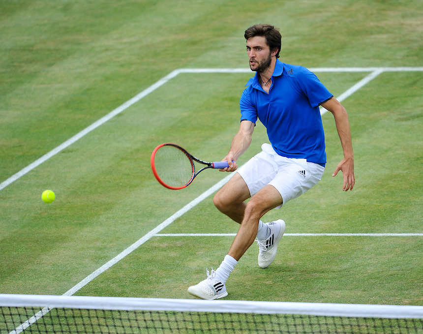 Gilles Simon in action against Andy Murray in the third singles rubber match today<br /> <br /> Photographer Ashley Western/CameraSport<br /> <br /> International Tennis - 2015 Davis Cup by BNP Paribas - World Group Quarterfinals - Great Britain v France - Day 3 - Sunday 19th July 2015 - Queens Club - London<br /> <br /> &copy; CameraSport - 43 Linden Ave. Countesthorpe. Leicester. England. LE8 5PG - Tel: +44 (0) 116 277 4147 - admin@camerasport.com - www.camerasport.com.