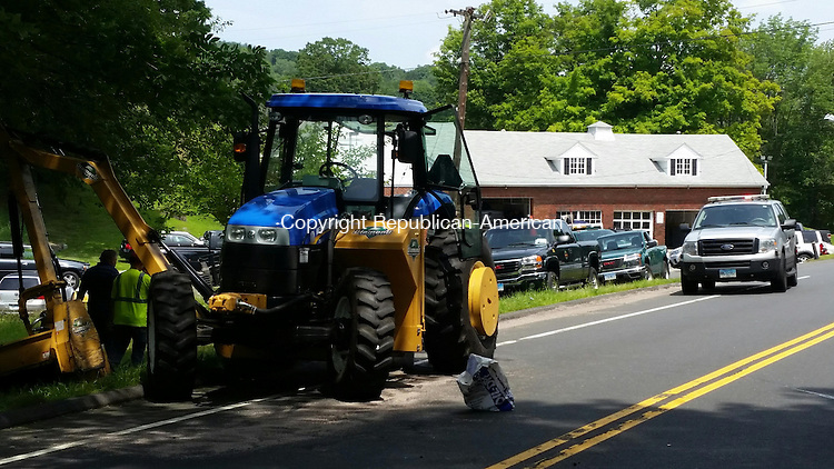 MIDDLEBURY, CT: 29 July 2015:072915BB01: MIDDLEBURY --- A clean up and accident investigation is conducted around the town tractor struck by a Honda CRV Wednesday morning. Bill Bittar Republican-American