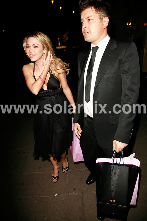 **ALL ROUND PICTURES FROM SOLARPIX.COM**.*WORLDWIDE RIGHTS*.Adele and Brian Dowling leave The Pink Ice Ball for Cancer Research UK on 5th October, 2007 at the Waldorf Hilton, London, England..JOB REF: 4941    GMT   DATE:  05.10.07.**MUST CREDIT SOLARPIX.COM OR DOUBLE FEE WILL BE CHARGED* *UNDER NO CIRCUMSTANCES IS THIS IMAGE TO BE REPRODUCED FOR ANY ONLINE EDITION WITHOUT PRIOR PERMISSION*