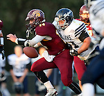 MADISON, SD - SEPTEMBER 11:  Mitch Hansen #14 from Madison is brought down from behind by Bryce Edberg #61 from West Central in the first half of their game Friday night in Madison. (Photo by Dave Eggen/Inertia)