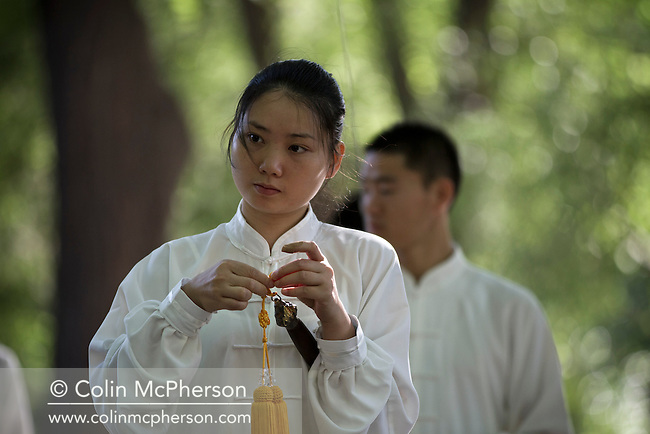 A woman wearing a white uniform and holding a ceremonial sword taking part in an early morning tai chi session at Purple Bamboo (Zizhuyuan) Park, Beijing. T'ai chi ch'uan or Taijiquan, often shortened to t'ai chi, taiji or tai chi in English usage, is a type of internal Chinese martial art practiced for both its defense training and its health benefits. It was also typically practiced for a variety of other personal reasons: its hard and soft martial art technique, demonstration competitions, and longevity.