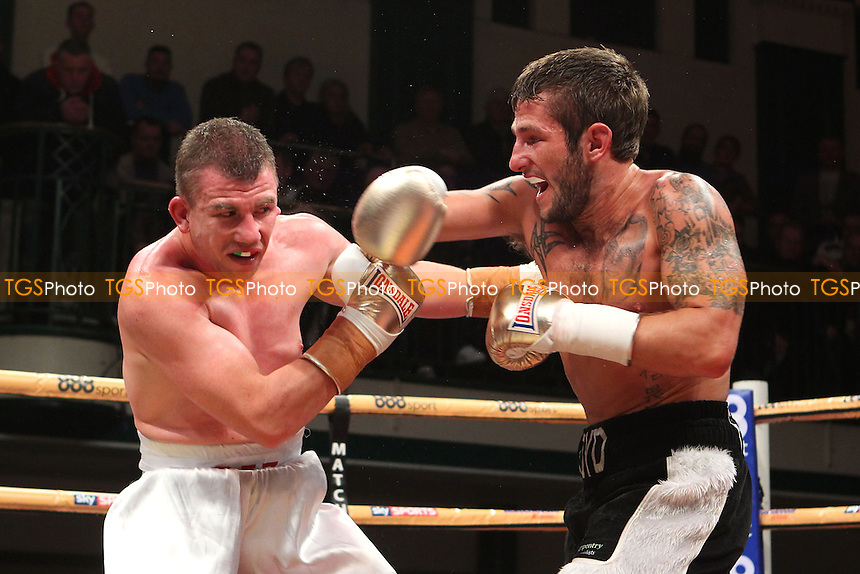 Gary Buckland (white shorts) defeats Floyd Moore in a Prizefighter The Lightweights boxing QF contest, promoted by Matchroom Sports - 06/12/14 - MANDATORY CREDIT: Gavin Ellis/TGSPHOTO - Self billing applies where appropriate - contact@tgsphoto.co.uk - NO UNPAID USE