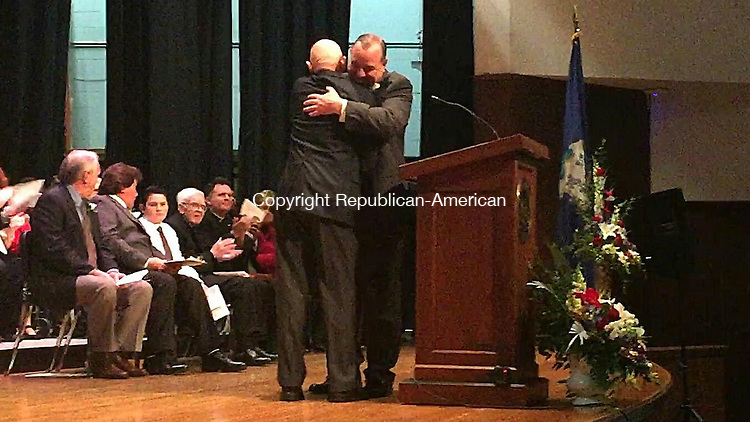 WATERBURY, CT - 1 December 2015 - 120115PO01 - Waterbury Mayor Neil M. O'Leary hugs his former partner, Retired Police Lt. Robert Deely, on Tuesday after Deely administers the oath of office to start O'Leary's third term.