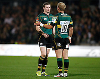 Photo: Richard Lane/Richard Lane Photography. Northampton Saints v Castres Olympique. Heineken Cup. 08/10/2010. Saints' Chris Ashton talks to Shane Geraghty.