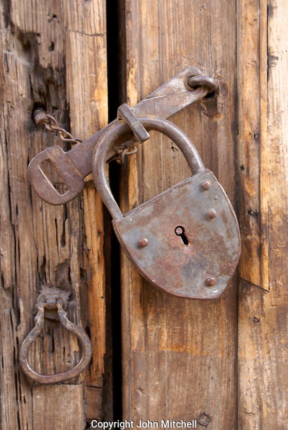 Old padlock on the door of a Spanish colonial building in San Miguel de Allende, Mexico