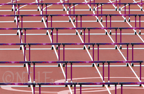 03 AUG 2012 - LONDON, GBR - Hurdles in position for the women's 100m hurdles Heptathlon heats at the London 2012 Olympic Games athletics in the Olympic Stadium in the Olympic Park in Stratford, London, Great Britain (PHOTO (C) 2012 NIGEL FARROW)