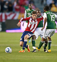 CARSON, CA – June 3, 2011: Chivas USA midfielder Jorge Flores (19) shields the ball from a Portland Timbers player during the match between Chivas USA and Portland Timbers at the Home Depot Center in Carson, California. Final score Chivas USA 1, Portland Timbers 0.